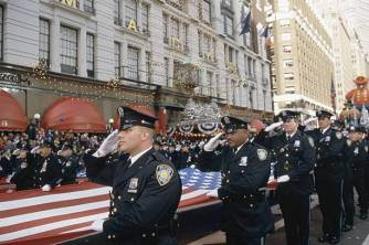 MACY'S THANKSGIVING DAY PARADE -- Pictured: New York police officers carry an American flag during the 2001 Macy's Thanksgiving Day Parade -- Photo by: Eric Liebowitz/NBCU Photo Bank